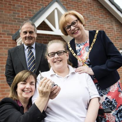 Debbie with colleagues outside her new home