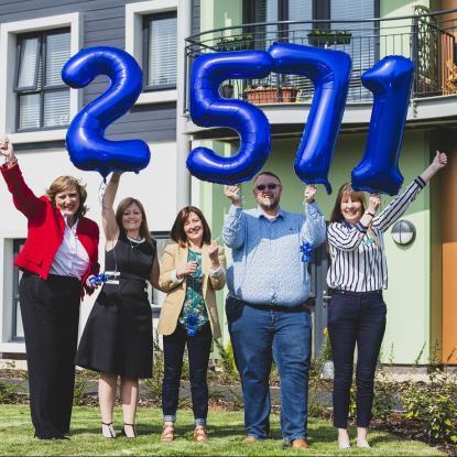 Sarah Boden, Jan Goode, Lyndsey Smith, Elliot Ashton of Sands, Pauline Lewis holding up numbered balloons totaling 2571