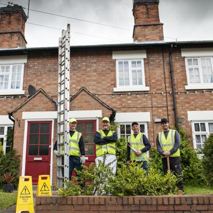 The MOT team is pictured outside a property while working on SSHA homes in Penkridge.