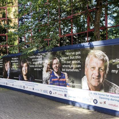 The posters are shown on the hoardings outside Reynolds House